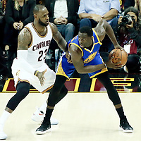 07 June 2017: Cleveland Cavaliers forward LeBron James (23) defends on Golden State Warriors forward Draymond Green (23) during the Golden State Warriors 118-113 victory over the Cleveland Cavaliers, in game 3 of the 2017 NBA Finals, at  the Quicken Loans Arena, Cleveland, Ohio, USA.