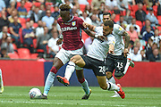 Aston Villa striker(on loan from Chelsea) Tammy Abraham (18) holds off the attentions of Derby County striker Mason Bennett (20) during the EFL Sky Bet Championship play off final match between Aston Villa and Derby County at Wembley Stadium, London, England on 27 May 2019.