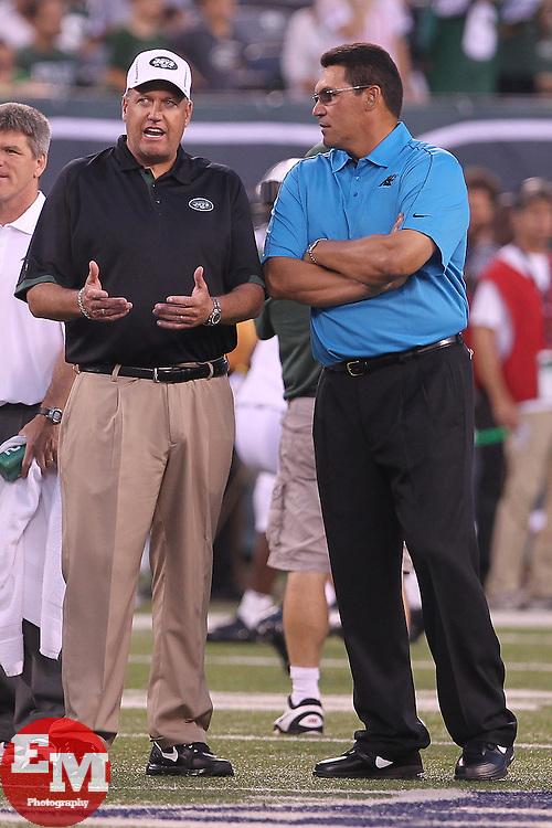 Aug 26, 2012; East Rutherford, NJ, USA; New York Jets head coach Rex Ryan and Carolina Panthers head coach Ron Rivera talk during warmups at MetLife Stadium.
