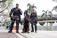 3 armed and armoured police officers with a large police dog in front of the Maracana stadium. A significantly increased police presence is in evidence around the Maracana stadium before the 2014 FIFA World Cup match at Maracana Stadium, Rio de Janeiro, Brazil. This follows the storming of the Stadium Media Centre by Chilean fans earlier in the week. <br /> Picture by Andrew Tobin/Focus Images Ltd +44 7710 761829<br /> 22/06/2014