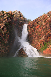 Floodwater flows over Turtle Falls in Dugong Bay in the Kimberley wet season