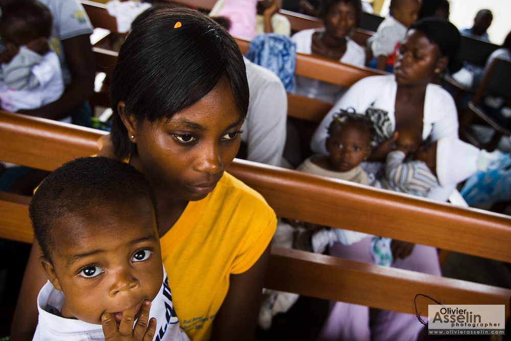 Monica Dahlu and her 10-month-old boy Lloyd Gyimah wait at the Osu Maternity Home in Accra, Ghana on Tuesday June 16, 2009.