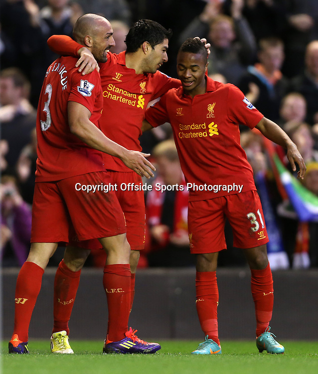 17th November 2012 - Barclays Premier League - Liverpool vs. Wigan Athletic - Luis Suarez of Liverpool (C) celebrates with Jose Enrique of Liverpool (L) and Raheem Sterling of Liverpool (R) after scoring their 3rd goal - Photo: Simon Stacpoole / Offside.