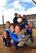 Local kids playing street soccer in Rocklands a Township outside of Bloemfontein South Africa on 23 June 2009, during the 2009 Confederations cup in South Africa. Photo:Gerhard Steenkamp/Superimage Media