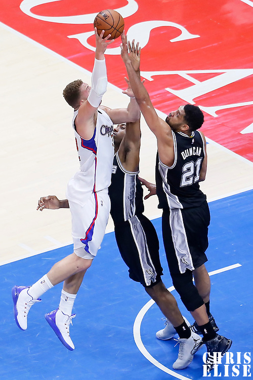 19 April 2014: Los Angeles Clippers forward Blake Griffin (32) goes for the baby hook over San Antonio Spurs forward Kawhi Leonard (2) and San Antonio Spurs forward Tim Duncan (21) during the Los Angeles Clippers 107-92 victory over the San Antonio Spurs, during Game One of the Western Conference Quarterfinals of the NBA Playoffs, at the Staples Center, Los Angeles, California, USA.