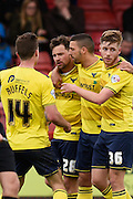 Oxford forward Chris Maguire celebrates his goal to make it 1-1 during the Sky Bet League 2 match between Crawley Town and Oxford United at the Checkatrade.com Stadium, Crawley, England on 9 April 2016. Photo by David Charbit.