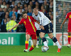 12.10.2012, Cardiff City Stadium, Cardiff, WAL, FIFA WM Qualifikation, Wales vs Schottland, im Bild Wales' Joe Allen in action against Scotland's Alan Hutton during during FIFA World Cup Qualifier Match between Wales and Scotland at the Cardiff City Stadium, Cardiff, Wales on 2012/10/12. EXPA Pictures © 2012, PhotoCredit: EXPA/ Propagandaphoto/ David Rawcliffe..***** ATTENTION - OUT OF ENG, GBR, UK *****