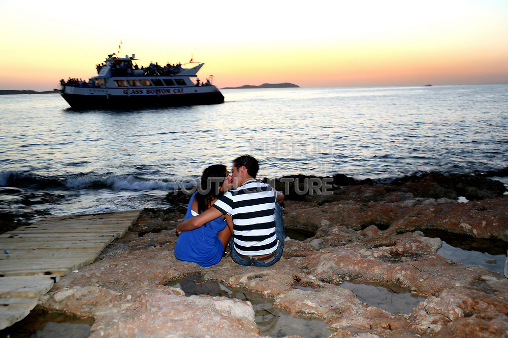 Couple kissing at sunset at Cafe Del Mar, Ibiza, 2006