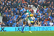 Rohan Ince and Blackburn's Ryan Tunnicliffe tussle for the ball during the Sky Bet Championship match between Brighton and Hove Albion and Blackburn Rovers at the American Express Community Stadium, Brighton and Hove, England on 8 November 2014.