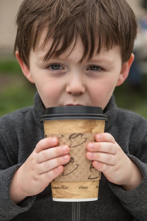 Henry Swenton savors a cup of hot chocolate at the Calistoga Saturday Market.
