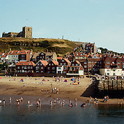 Whitby, North Yorkshire, England, showing Whitby Abbey on the hillside overlooking the town. Whitby is a seaside town situated on the East coast of Yorkshire at the mouth of the River Esk, Whitby, North Yorkshire, England. 23rd July 2011. Photo Tim Clayton