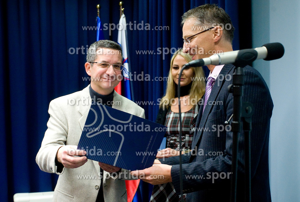 Rajmond Debevec and minister Igor Luksic at reception of some best Slovenian sportsmen at Ministry of Education and Sport when they receive special financial prizes for their achievements in year 2009, on October 30, 2009, in Ljubljana, Slovenia.   (Photo by Vid Ponikvar / Sportida)