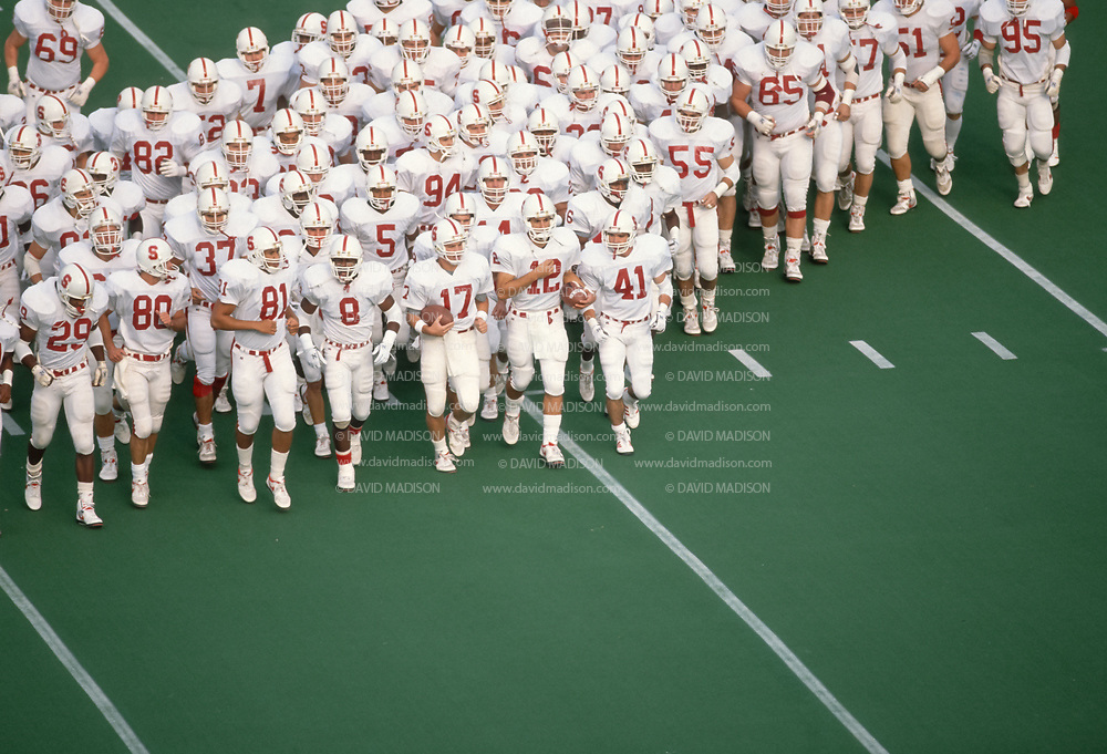 BERKELEY, CA - NOVEMBER 17:  The Stanford Cardinal football team jogs on the field prior to the 1990 Big Game between Stanford and Cal played on November 17, 1990 at Memorial Stadium in Berkeley, California.  Visible players include Cory Booker #81, John Lynch #17, and Jason Palumbis #12. Photo by David Madison www.davidmadison.com
