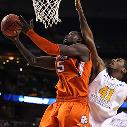 Mar 17, 2011; Tampa, FL, USA; Clemson Tigers guard Tanner Smith (5) shoots over West Virginia Mountaineers forward John Flowers (41) during the first half of the second round of the 2011 NCAA men's basketball tournament at the St. Pete Times Forum.  Mandatory Credit: Derick E. Hingle