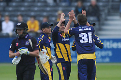 Michael Hogan of Glamorgan celebrates with his team as he bowls out Geraint Jones of Gloucestershire for 25 - Photo mandatory by-line: Dougie Allward/JMP - Mobile: 07966 386802 - 12/06/2015 - SPORT - Cricket - Bristol - County Ground - Gloucestershire v Glamorgan - Natwest T20 Blast