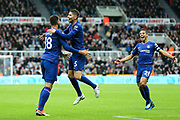 Jorginho (#5) of Chelsea celebrates with Olivier Giroud (#18) of Chelsea as Chelsea take the lead through an own goal (1-2) during the Premier League match between Newcastle United and Chelsea at St. James's Park, Newcastle, England on 26 August 2018.