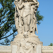 John Ericsson National Memorial with Vision Figure. The John Ericsson National Memorial, on the bank of the Potomac River near the Lincoln Memorial, is a monument to Civil War naval engineer John Ericsson, the designer of the breakthrough iron-clad naval vessel USS Monitor. The memorial was designed by architect Albert Randolph Ross and sculpted by James Earle Fraser from the same pink granite used in the Lincoln Memorial. Because Ericsson was Swedish-born, the memorial consists of a combination of symbolic elements from his birthplace and his adopted homeland.