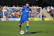 AFC Wimbledon defender George Francomb (7) passing the ball during the EFL Sky Bet League 1 match between AFC Wimbledon and Southend United at the Cherry Red Records Stadium, Kingston, England on 25 March 2017. Photo by Matthew Redman.