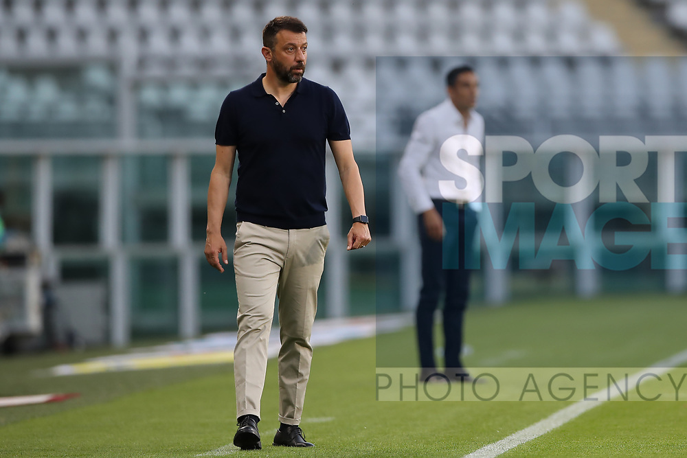 Parma Calcio's Italian Head coach Roberto D'Aversa with Torino FC's Italian Head coach Moreno Longo pictured in the background during the Serie A match at Stadio Grande Torino, Turin. Picture date: 20th June 2020. Picture credit should read: Jonathan Moscrop/Sportimage