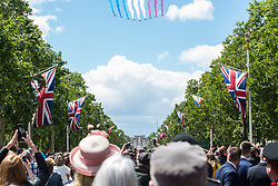 London, UK. 8 June, 2019. Crowds line the Mall after the Trooping the Colour ceremony for a flypast over Buckingham Palace by the Red Arrows, the Royal Air Force Aerobatic Team, to mark the Queen's official birthday.