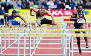 Great Britain's Andy Turner (R) competes next to USA's Joel Brown (L) and David Oliver, in the men's 110m hurdels final  during the Diamond League athletics meeting at Crystal Palace in London on August 14, 2010.