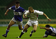 24/05/2002 (Friday).Sport -Rugby Union - London Sevens.England vs Samoa.Josh Lewsey runs through the Samoan defence[Mandatory Credit, Peter Spurier/ Intersport Images].