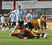 Jim McAlister is outnumbered by Partick Thistle's Stuart Bannigan and Daniel Seaborne - Dundee v Partick Thistle, SPFL Premiership at Dens Park<br /> <br />  - &copy; David Young - www.davidyoungphoto.co.uk - email: davidyoungphoto@gmail.com