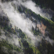 Misty mountain hop. Dramatic clouds and mist rising after a storm in Chamonix valley