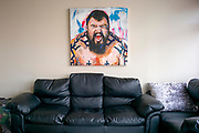 Eddie Hall aka &quot;The Beast&quot; - The Strongest Man in the World.<br /> A feature following what it takes to be Eddie Hall, who has become the first Brit to win World's Strongest Man competition in 24 years. <br /> Caption: A painting, painted by a fan, hangs on the wall of Eddie's house in Stoke-on-Trent. <br /> Photographer: Rick Findler / Story Picture Agency