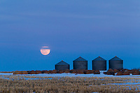 I took a trip out on the Prairie to the South and East of Calgary to watch the full moon rise at sunset. It was a spectacular sunset and the western sky was on fire as the sun dropped below the horizon.<br /> <br /> &copy;2013, Sean Phillips<br /> http://www.RiverwoodPhotography.com