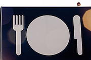 A dish with a knife and fork as symbol of American food 2.0, where American food 2.0 is the title of United States Pavilion in Expo 2015, Rho-Pero, Milan, in June 2015. &copy; Carlo Cerchioli <br /> <br /> Un piatto con forchetta e coltello come simbolo del Cibo americano 2.0, dove Cibo americano 2.0 &egrave; il titolo del padiglione degli Stati Uniti a Expo 2015, Rho-Pero, Milano, giugno 2015.