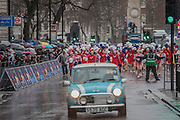 A large group of cheerleaders charge after one of the minis on Whitehall - The New Years day parade passes through central London form Piccadilly to Whitehall. London 01 Jan 2017
