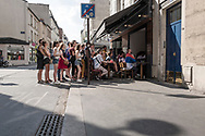 From the street,  French supporters watch France vs Croatia in 2018 World Cup final on Daguerre street, Paris, 15 July 2018.