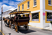 Tourists in horse drawn carriage sightseeing in St George, Bermuda