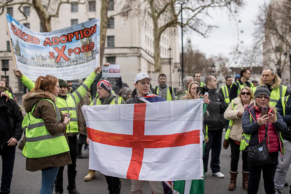 """© Licensed to London News Pictures. 12/01/2019. London, UK. Pro-Brexit """"yellow vest"""" protesters outside Downing Street in London. James Goddard, who was involved in an incident with Conservative MP Anna Soubry, was arrested by police this morning. Photo credit: Rob Pinney/LNP"""