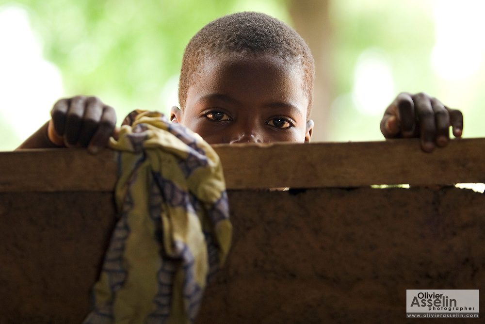 A child peeks through a window at the Ying Anglican Primary School in the Savelugu-Nanton district, northern Ghana on Monday June 4, 2007.