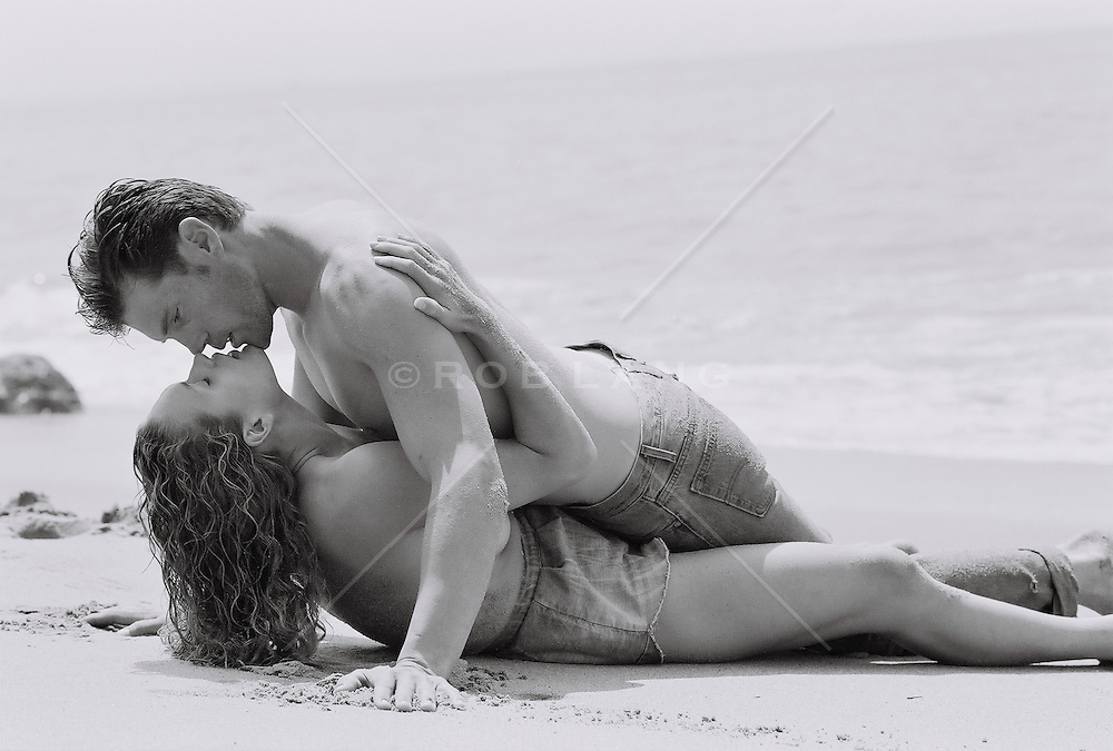 Young couple kissing at beach