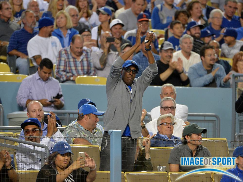 Sept 1, 2015; Los Angeles, CA, USA; Entertainer and comedians George Lopez (left) and Arsenio Hall attend the MLB game between the San Francisco Giants against the Los Angeles Dodgers at Dodger Stadium.