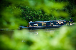 A moored canal barge in the lower basin at Foxton Locks on the Grand Union Canal, Leicestershire, England, UK.