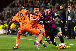 BARCELONA, March 14, 2019  Barcelona's Lionel Messi (R) vies with Lyon's Tanguy NDombele (L) and Fernando Marcal during the UEFA Champions League match between Spanish team FC Barcelona and French team Lyon in Barcelona, Spain, on March 13, 2019. Barcelona won 5-1 and advanced to the quarterfinals. (Credit Image: © Joan Gosa/Xinhua via ZUMA Wire)