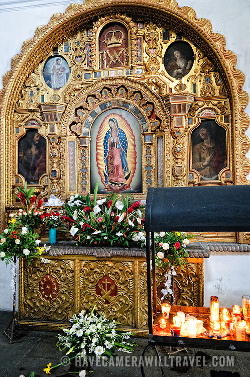 An ornate altar depicting Our Lady of Guadalupe in Iglesia de San Francisco in Antigua, Guatemala.