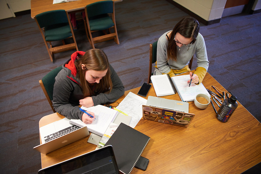 Activity; Studying; Smiling; Buildings; Dorm; Eagle Hall; Location; Inside; Objects; Computer; notepad; People; Woman Women; Student Students; Type of Photography; Candid; UWL UW-L UW-La Crosse University of Wisconsin-La Crosse; Winter; February
