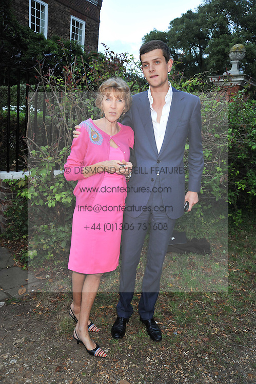 LADY JANE SPENCER-CHURCHILL and her son the HON.ALEXANDER SPENCER-CHURCHILL at a Summer party hosted by Lady Annabel Goldsmith at her home Ormeley Lodge, Ham, Surrey on 14th July 2009.