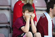 A young Northampton Town fan looks dejected during the EFL Sky Bet League 1 match between Northampton Town and Oldham Athletic at Sixfields Stadium, Northampton, England on 5 May 2018. Picture by Dennis Goodwin.