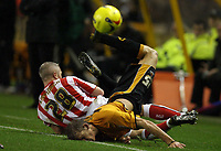 Photo: Rich Eaton.<br /> <br /> Wolverhampton Wanderers v Sunderland. Coca Cola Championship. 24/11/2006. Daniel Jones right of Wolves is tackled by Graham Kavanagh of Sunderland