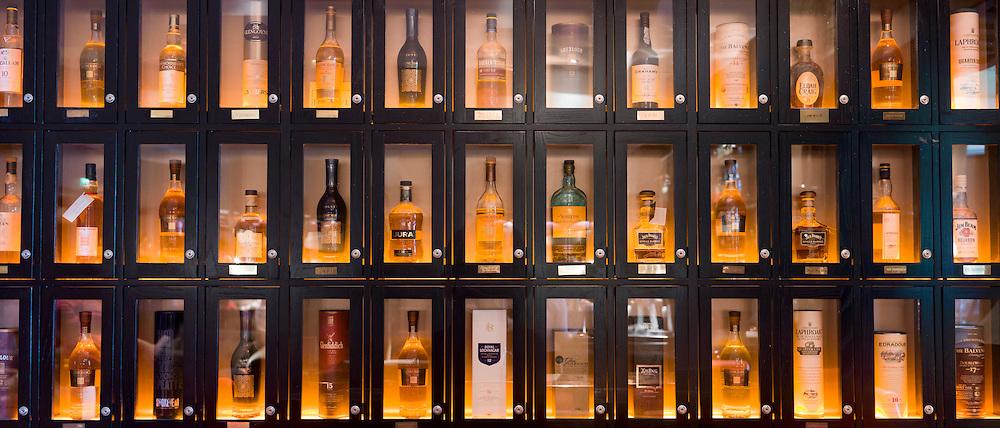 Customers' individual whisky lockers for Single malt Scotch whisky - among them Glenmorangie, Balvenie, Laphroig, Glengoyne, Jura, Ardbeg, Glenfiddich. - in the Great Scots Bar at The Cameron House Hotel Glasgow, Scotland