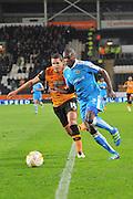 Jeremy Helan (3) of Wolverhampton Wanderers and Hull City midfielder Jake Livermore (14) during the Sky Bet Championship match between Hull City and Wolverhampton Wanderers at the KC Stadium, Kingston upon Hull, England on 15 April 2016. Photo by Ian Lyall.