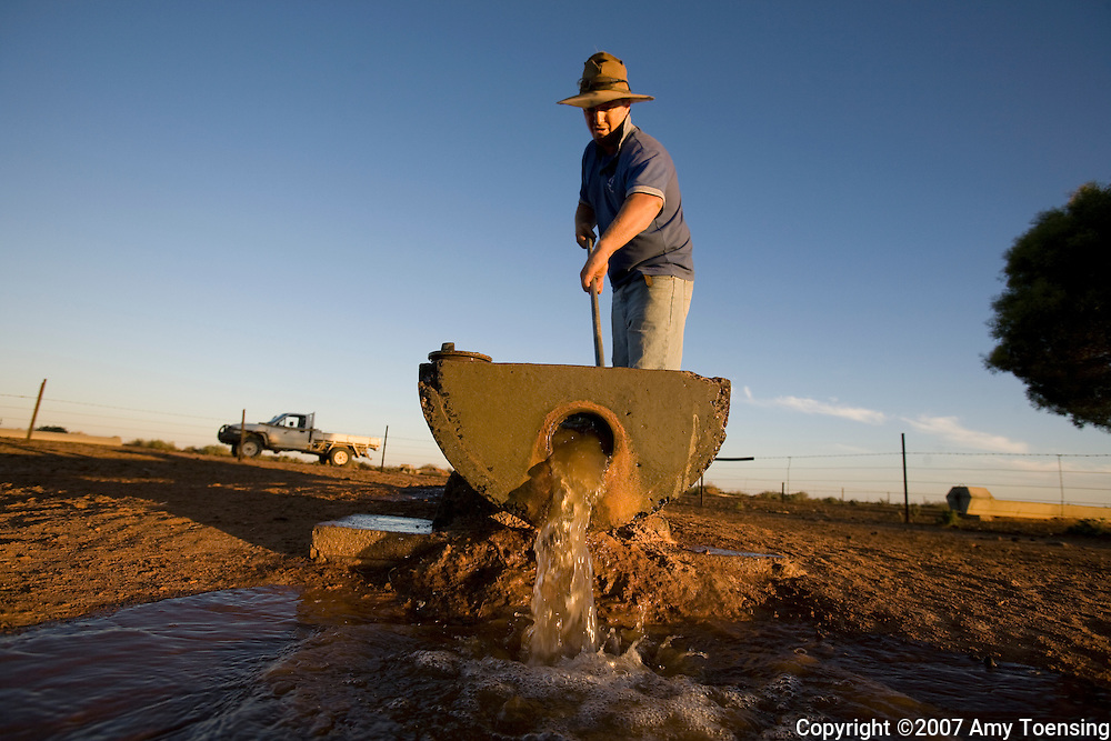 IVANHOE, NSW, AUSTRALIA - FEBRUARY 9: Darren Turner cleans watering troughs and checks on windmills on his farm February 9, 2008 in Ivanhoe, New South Wales, Australia. The Turners, like many farm families in the Murray-Darling Basin have had to move most of their livestock to other regions of Australia because their own land is too dry to produce feed after years of drought. The Murray-Darling Basin of Australia has been plagued with severe drought since the late 1990's and many growers and policy makers are being forced to work on implementing more efficient irrigation systems. (Photo by Amy Toensing / Reportage by Getty Images). _________________________________<br />