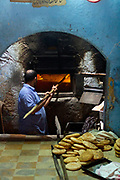 Baker prepares bread at a bakery in the Fez Medina (Fes), Morocco, 2013-10-25.<br />