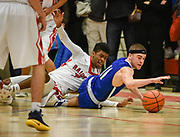 Beford High School junior Jack Cowan dives on the ground to grab a loose ball during the MIAA Division 3 North Sectional Final game against Watertown High School at Burlington High School, March 11, 2017. The Raiders won, 59-52.    [Wicked Local Photo/James Jesson]